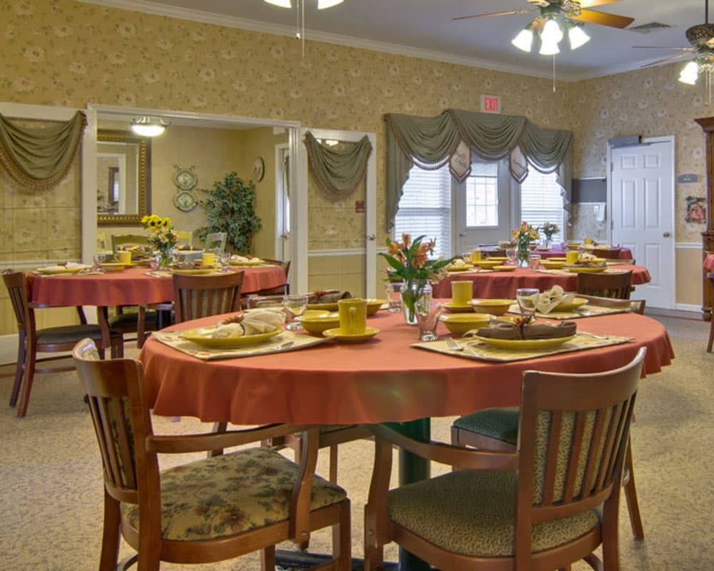 Well decorated dining area table at Bluff Creek Terrace Senior Living in Columbia, Missouri