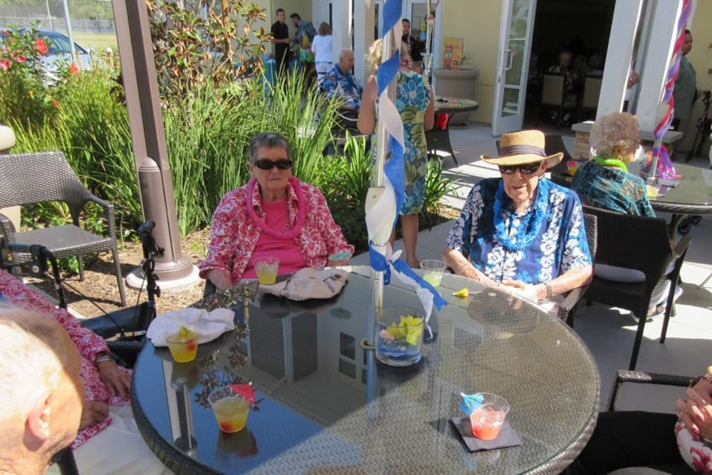 Residents Enjoying Time Together at Merrill Gardens at Huntington Beach in Huntington Beach, California.