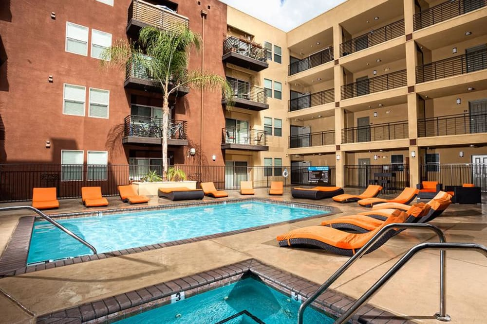 Swimming Pool Surrounded With Chairs at Avana North Hollywood Apartments in North Hollywood, CA
