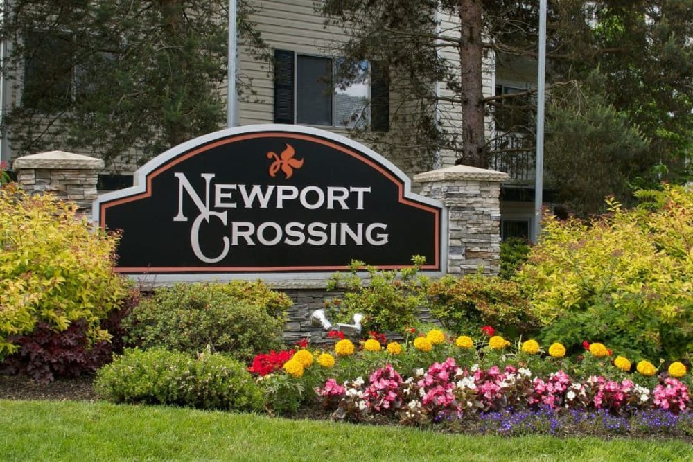 The front monument sign at Newport Crossing Apartments in Newcastle, Washington