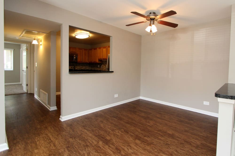 Living room and dining room area at Cypress Place in Elk Grove Village, Illinois