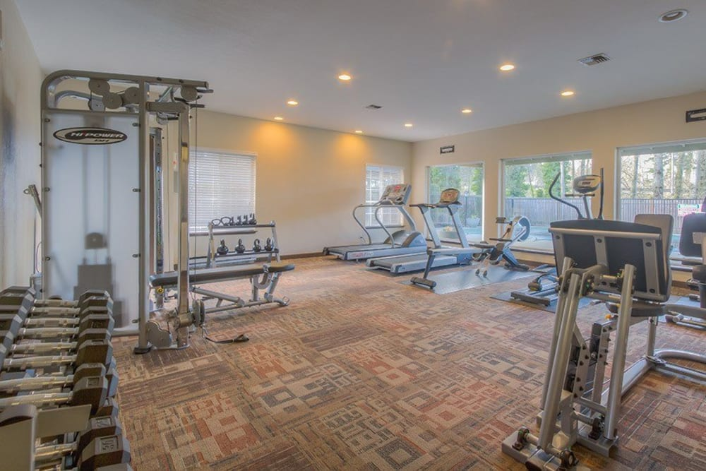 Fully equipped fitness center at Chestnut Hills Apartments in Puyallup, Washington