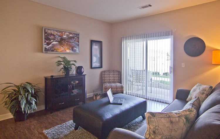 Crescent at Wolfchase offers a naturally well-lit living room in Memphis, Tennessee