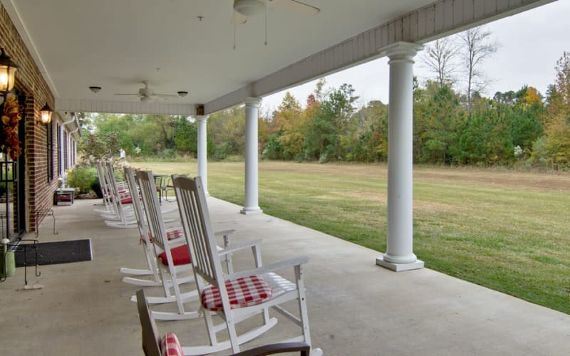 Outdoor porch with chairs at Montgomery Gardens in Starkville, Mississippi