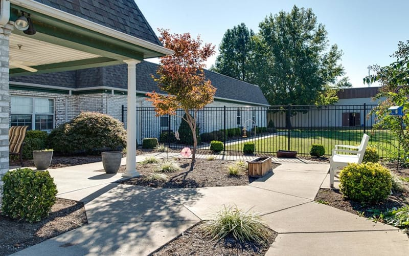 Front porch with chairs at The Arbors at WestRidge Place Senior Living in Sikeston, Missouri