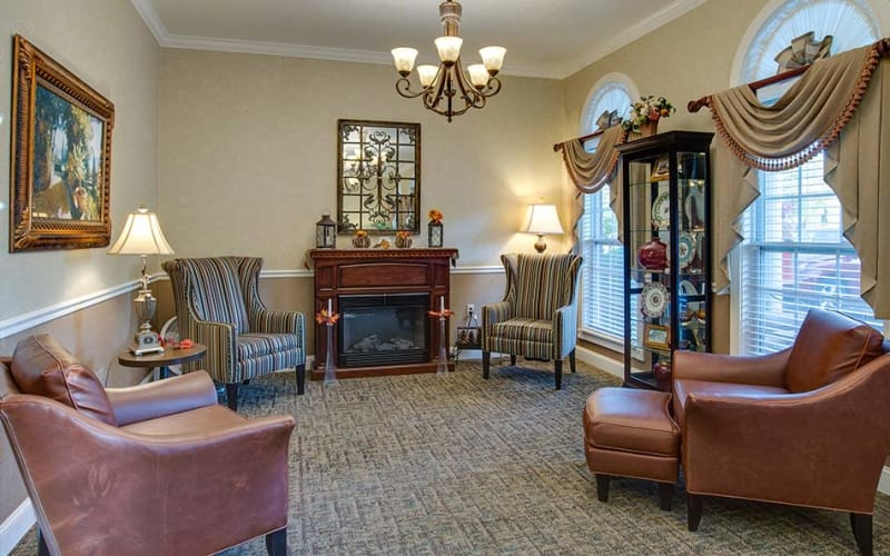 Quiet reading room with comfortable seating at Foxberry Terrace Senior Living in Webb City, Missouri
