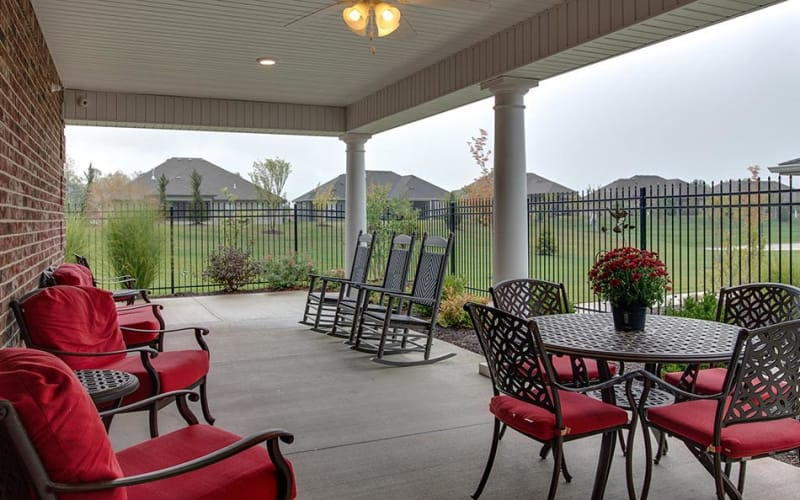 Outdoor patio with chairs at Mill Creek Village Senior Living in Columbia, Missouri