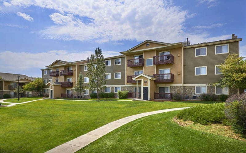 Brown and tan exterior of Crossroads at City Center Apartments in Aurora, Colorado