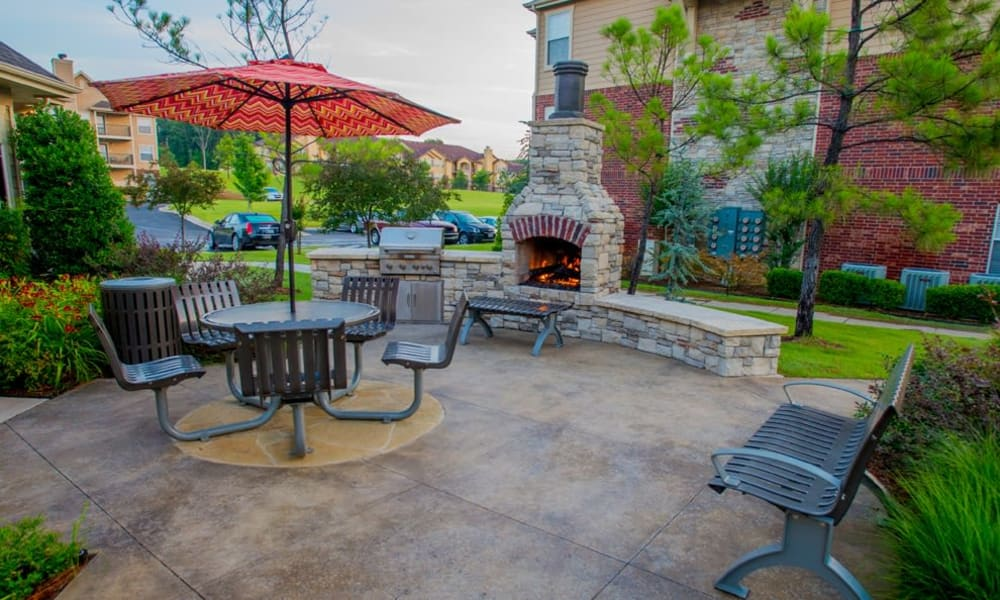 Outdoor seating with fireplace at Nickel Creek Apartments in Tulsa, Oklahoma