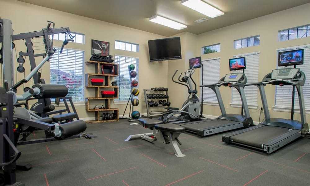 Fully-equipped fitness center at Nickel Creek Apartments in Tulsa, Oklahoma