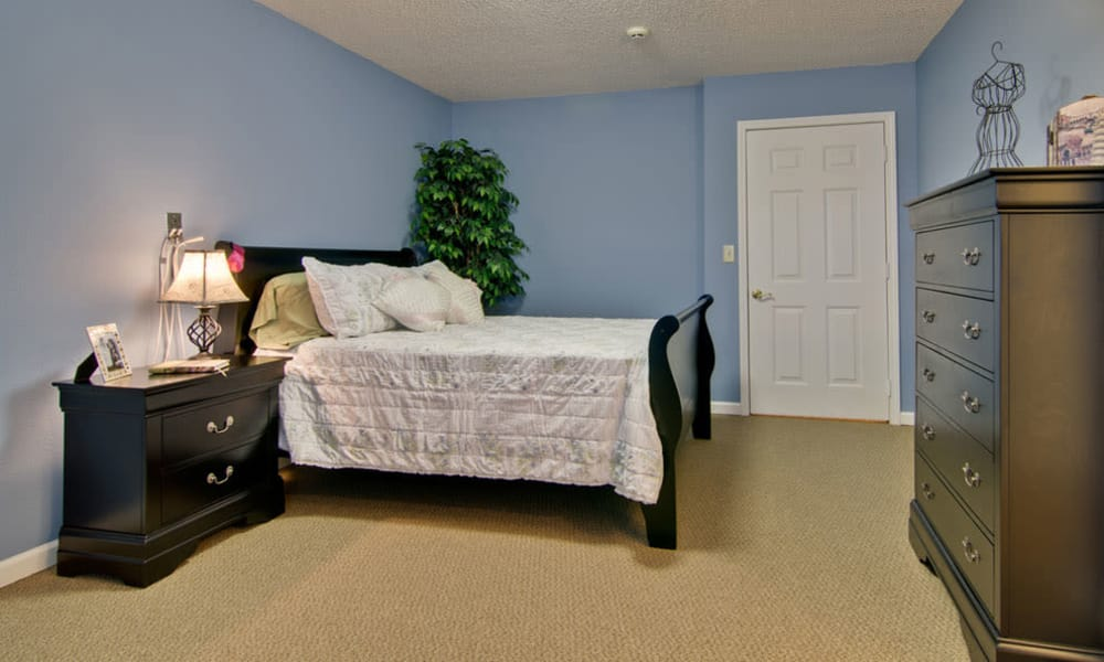 Cozy single bedroom for assisted living residents at Autumn Oaks in Manchester, Tennessee