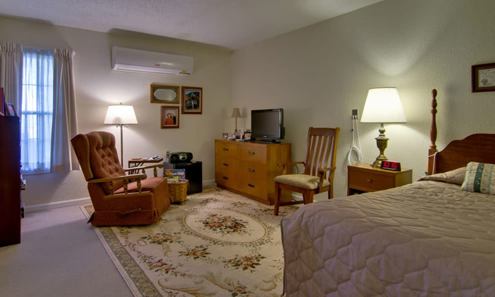 Large bedroom for assisted living residents at Churchill Terrace in Fulton, Missouri