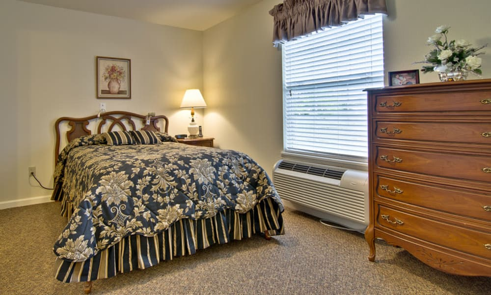 Large bedroom for assisted living residents at Jefferson Gardens in Clinton, Missouri