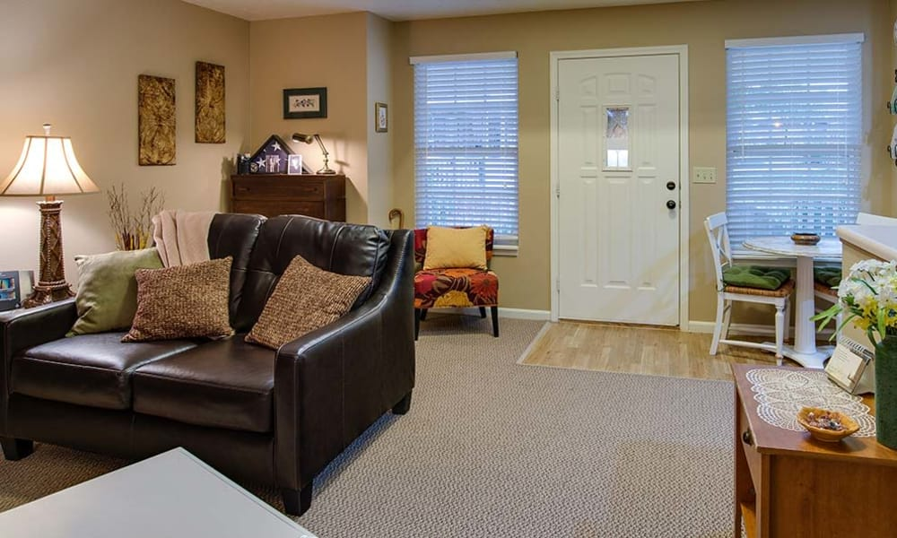 Cozy living room floor plan for assisted living residents at NorthPark Village Senior Living in Ozark, Missouri