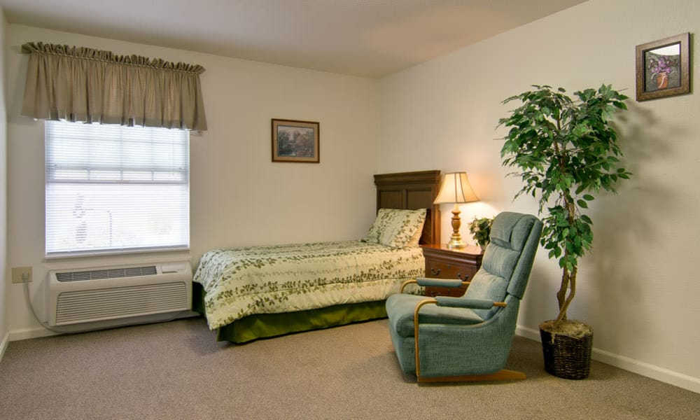 Large bedroom for assisted living residents at NorthRidge Place in Lebanon, Missouri