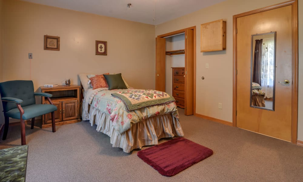 Single bedroom at Oswego Home Place in Oswego, Kansas