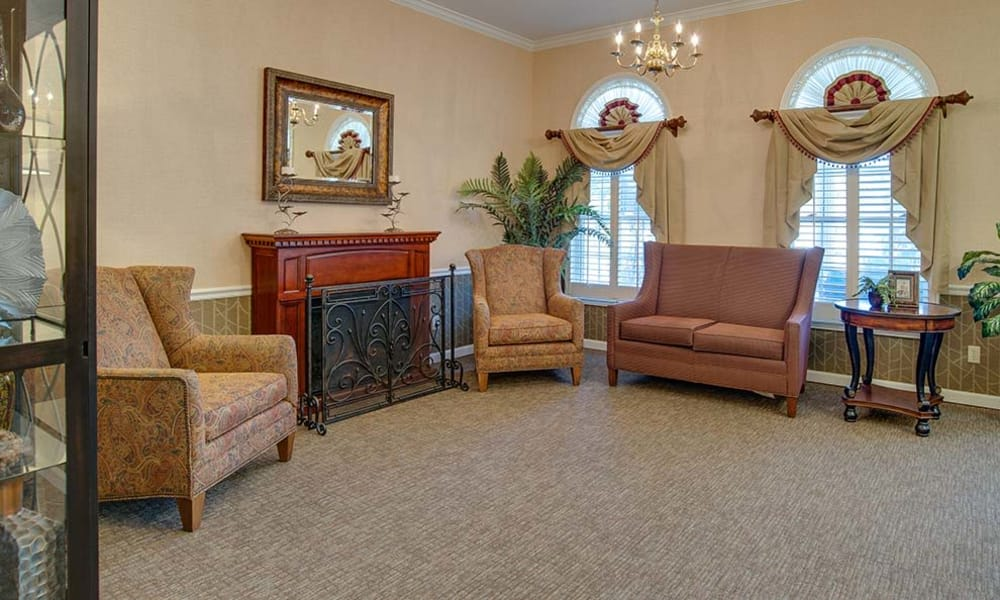 Cozy fireside lounge for assisted living residents at Parkwood Meadows Senior Living in Sainte Genevieve, Missouri