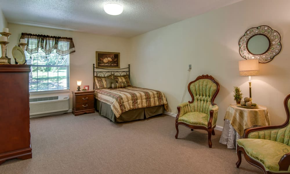 Large bedroom for assisted living residents at Riverview Terrace in McMinnville, Tennessee