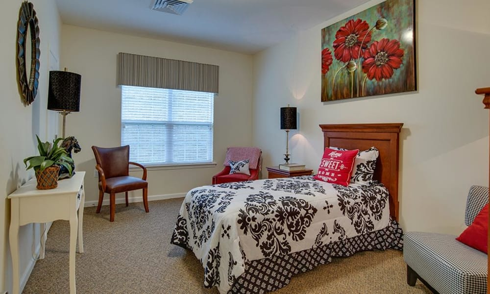 Beautiful bedroom at Mill Creek Village Senior Living in Columbia, Missouri