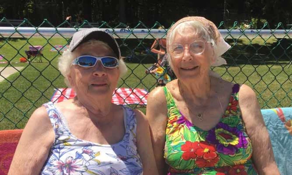 two women in swim suites sitting side by side at Heritage Hill Senior Community in Weatherly, Pennsylvania