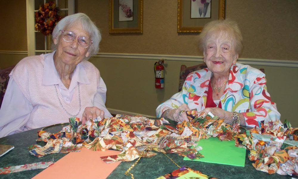 two residents working on arts and crafts at Heritage Hill Senior Community in Weatherly, Pennsylvania