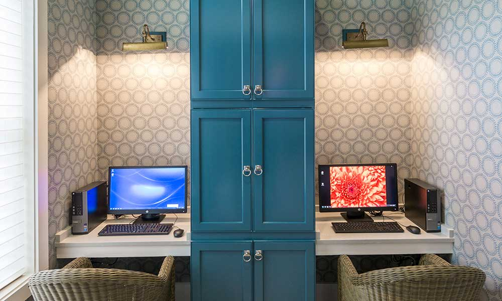 Business center with private workstations for resident use at Alaqua in Jacksonville, Florida