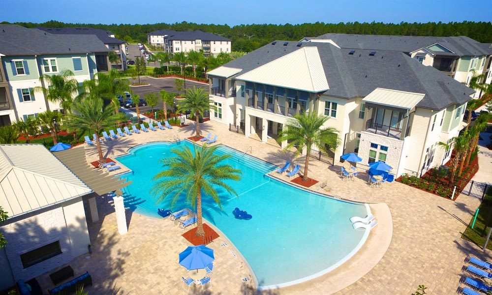 Low aerial view of the swimming pool and resident clubhouse at Alaqua in Jacksonville, Florida