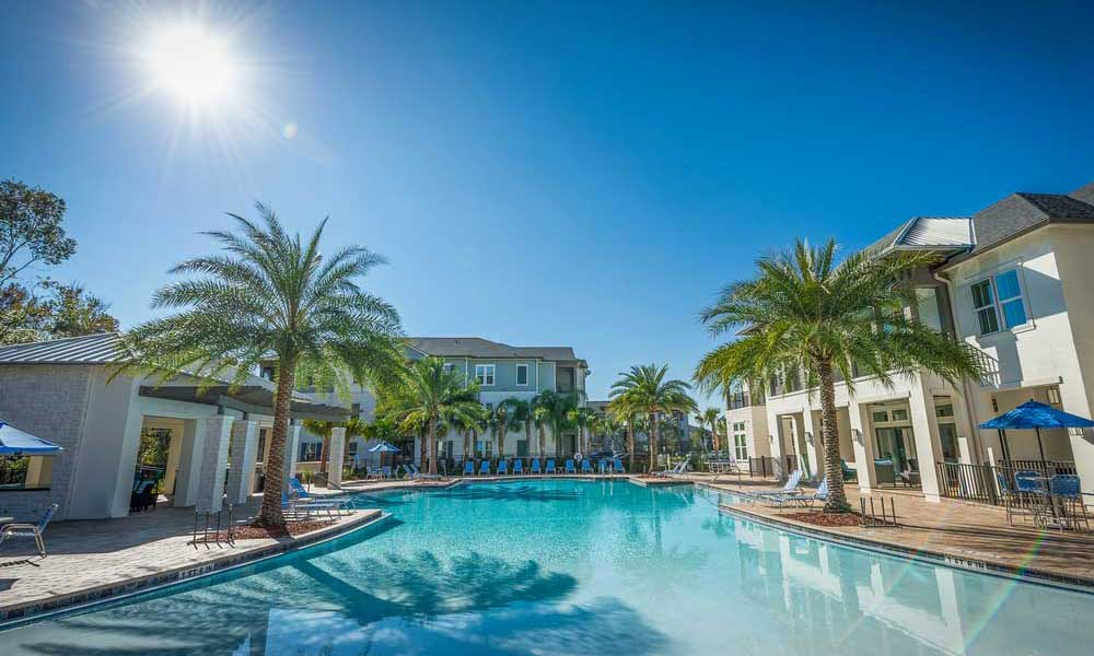 Gorgeous day at the swimming pool with beach-style entry at Alaqua in Jacksonville, Florida