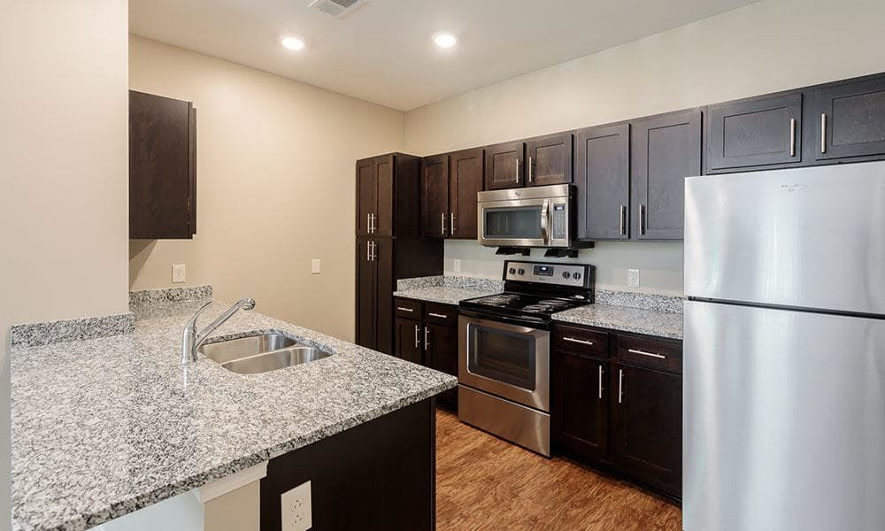 Canal Crossing offers modern kitchen in Camillus apartments