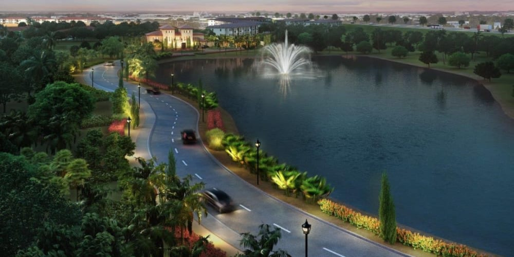 Aerial view at dusk of the lake with a fountain at our community at Doral View Apartments in Miami, Florida