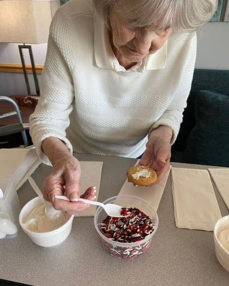 Resident decorating a pastry at Apple Creek Place in Appleton, Wisconsin