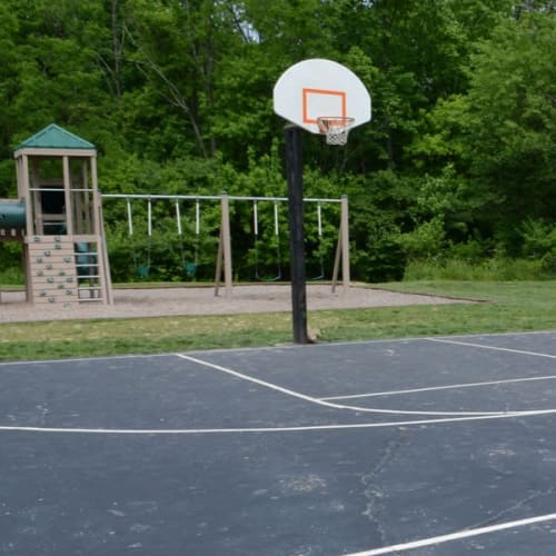 Basketball court and playground at Lakeside Landing Apartments in Lakeside Park, Kentucky