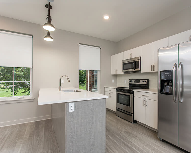 Well-equipped kitchen at 933 the U in Rochester, New York