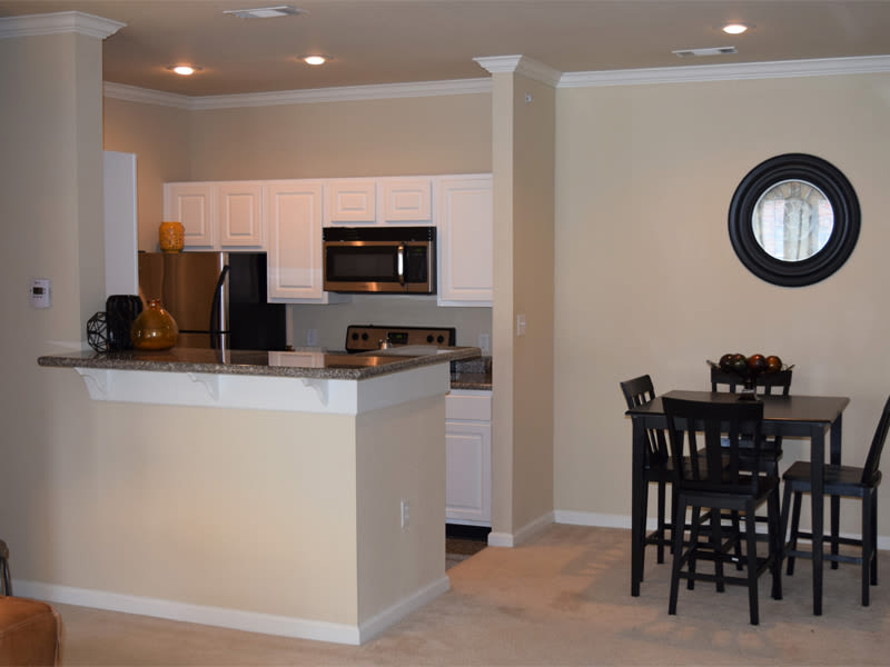 The kitchen and dining table at Lexington Park Apartment Homes