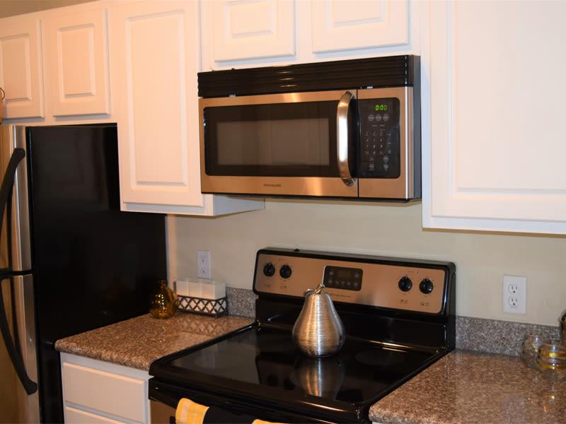 A glass top stove at Lexington Park Apartment Homes
