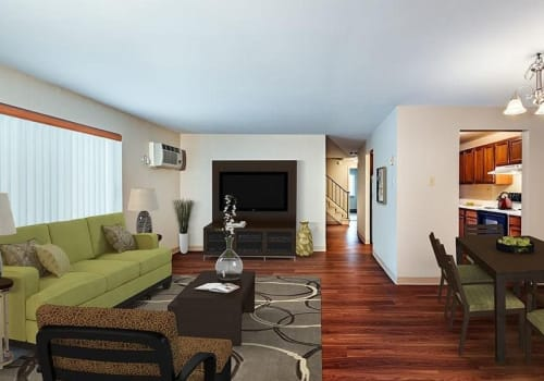 Living room with wood-style flooring at Maiden Bridge & Canongate Apartments in Pittsburgh, Pennsylvania