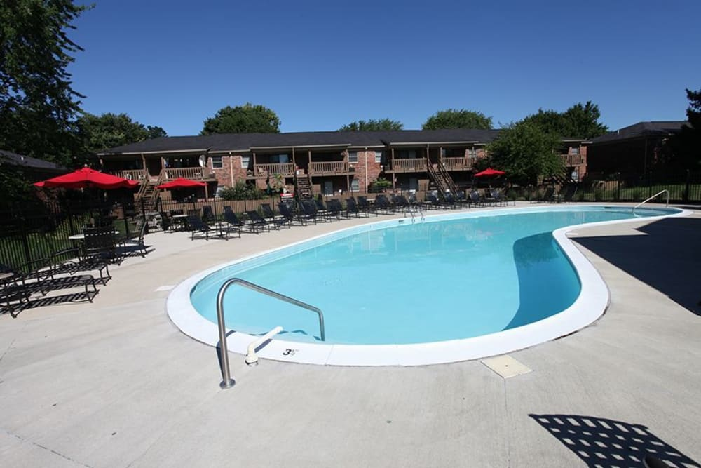 A swimming pool with a large sundeck at Valle Vista in Greenwood, Indiana