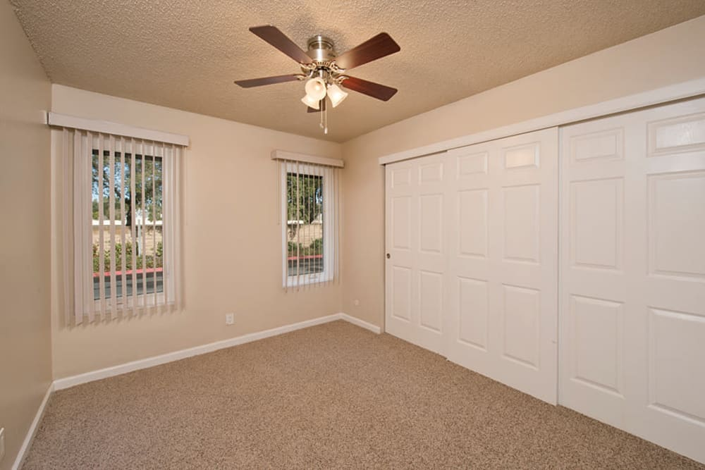Lovely bedroom featuring a ceiling fan at Villa Palms Apartment Homes in Livermore, California