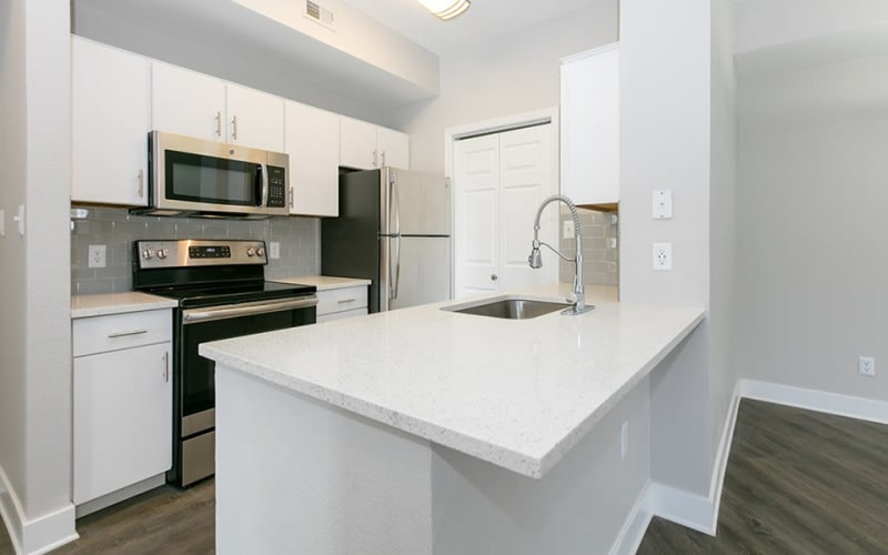Renovated kitchen with ample cabinet space and stylish finishes at Altitude Westminster in Westminster, Colorado