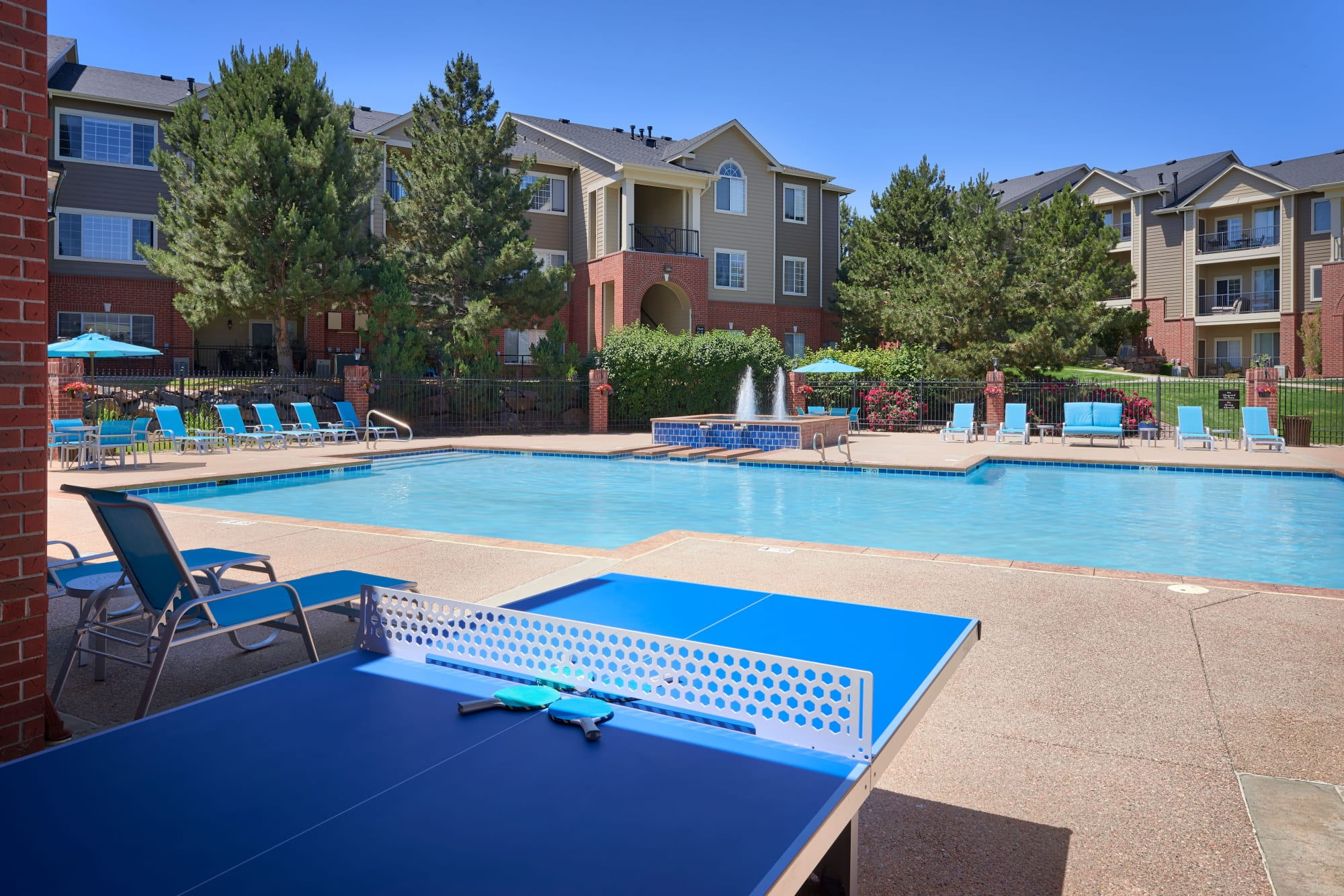 Poolside ping pong table at Skyecrest Apartments in Lakewood, Colorado
