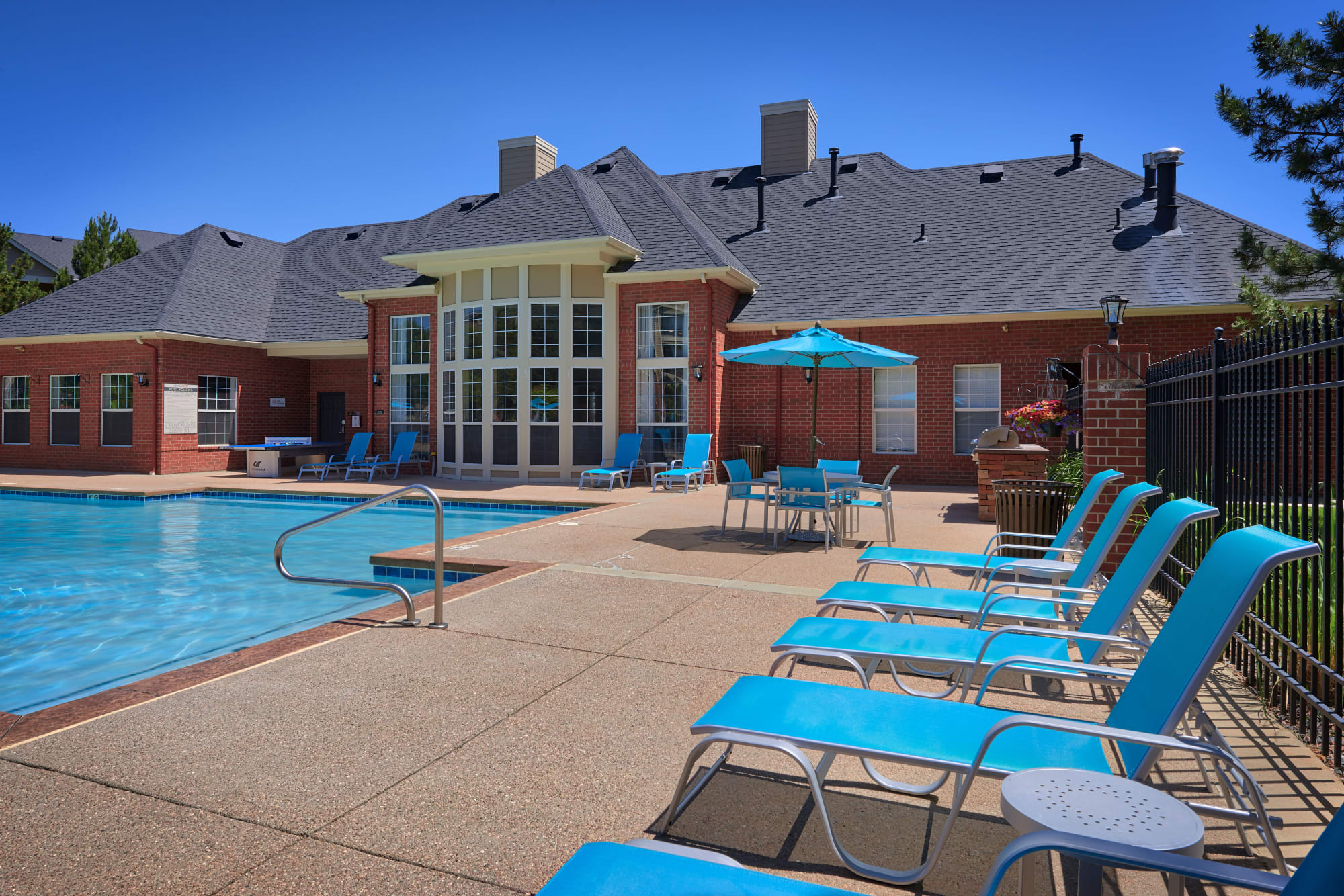 Poolside lounge chairs at Skyecrest Apartments in Lakewood, Colorado