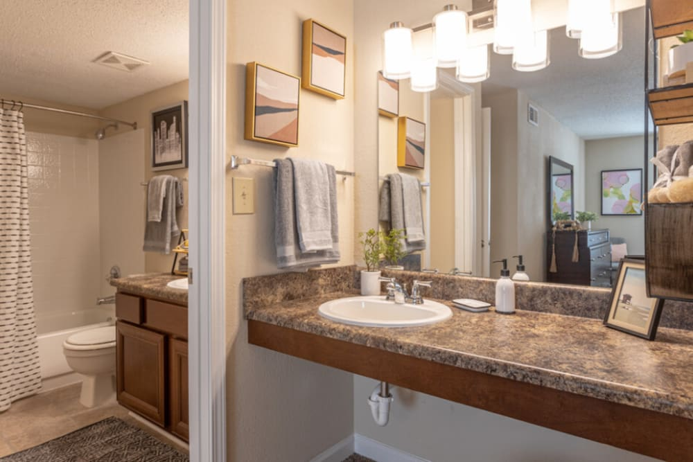 Elegantly designed bathroom at at The Abbey at Riverchase apartments in Hoover, AL