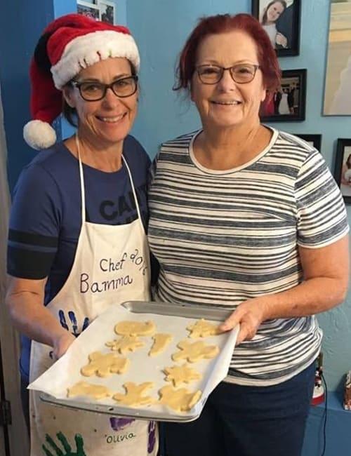 Staff members baking cookies at Inspired Living Ocoee in Ocoee, Florida.