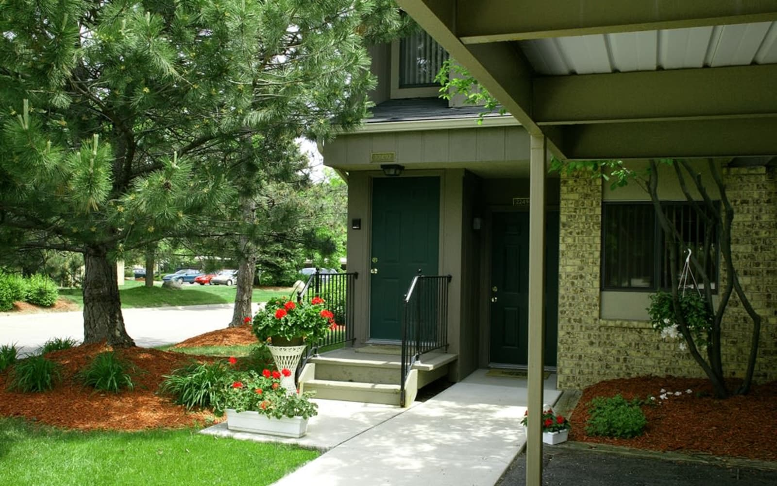 Walkway into an apartment in Farmington Hills, Michigan at Fairmont Park Apartments