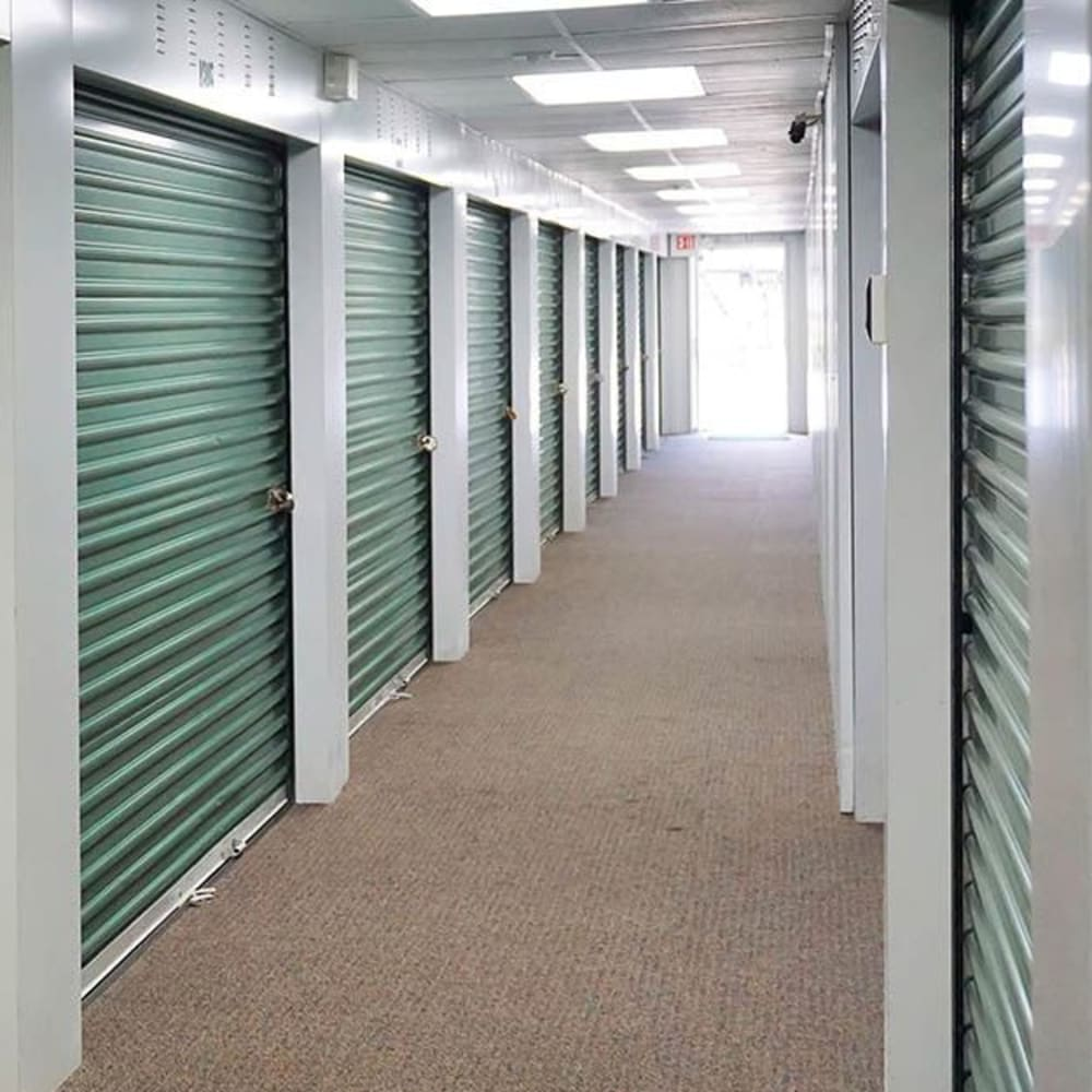 A hallway of indoor storage units at 3L Self Storage in Fort Wright, Kentucky