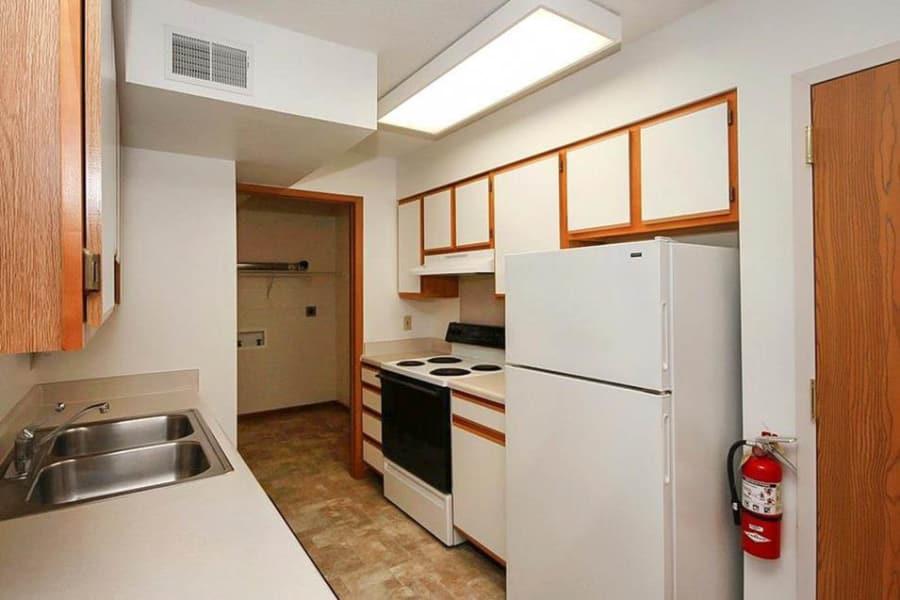 Kitchen with white appliances at Regency Heights in Iowa City, Iowa