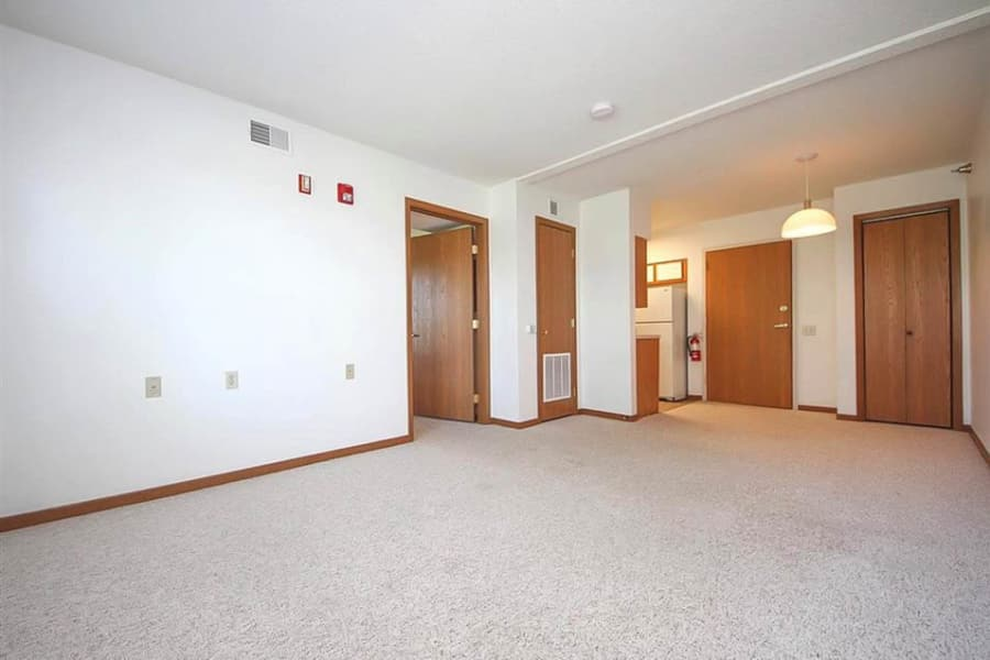 Spacious living area with carpet at Regency Heights in Iowa City, Iowa