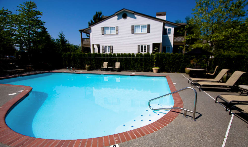 Sparkling pool with sun chairs at The Winsley in Everett, Washington