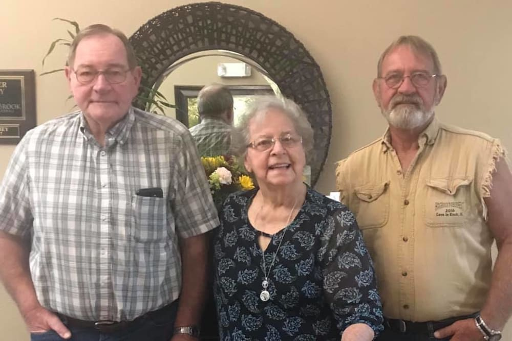 Happy residents posing for a photo at Villas of Holly Brook Marshall in Marshall, Illinois