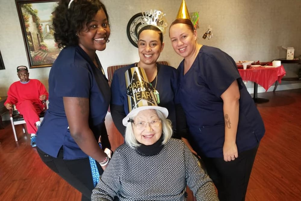 A resident and staff members celebrating at Legacy Oaks of Sacramento in Sacramento, California